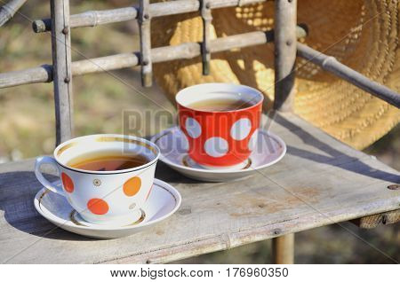 Rustic Still Life With A Cups Of Tea And Straw Hat