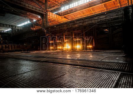 Working open hearth furnace. Production process in the steel mill