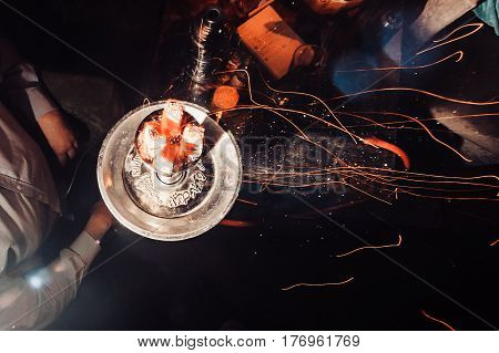 Shisha Hookah With Red Hot Coals. Sparks From Breathe. Modern Hookah With Coconut Charcoal For Relax