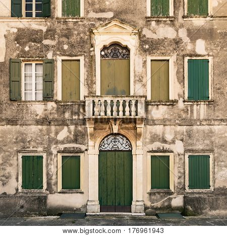 Detail of the facade of an ancient abandoned Italian villa.