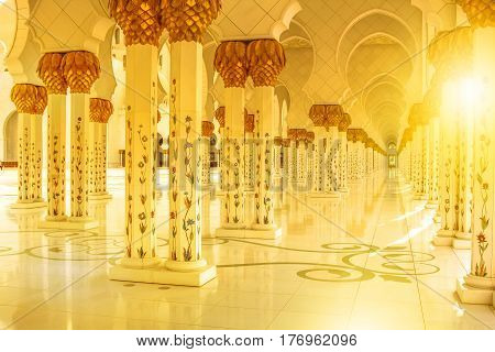 Abu Dhabi, United Arab Emirates - April 22, 2013: details of columns at daylight with decoration. Sheikh Zayed Grand Mosque the largest mosque in UAE.Islamic cultures concept and muslim religious icon