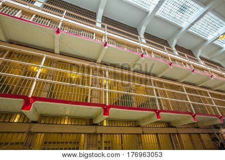 San Francisco, California, United States - August 14, 2016: Alcatraz main cells on three levels. All the cells are single for the best control of inmates. Tourists visiting the prison in guided tour.