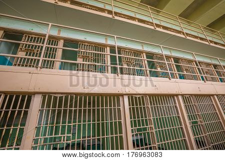 San Francisco, California, United States - August 14, 2016: interior of Alcatraz three level cells. People visiting prison in touristic tour every day from San Francisco port. Historical site landmark
