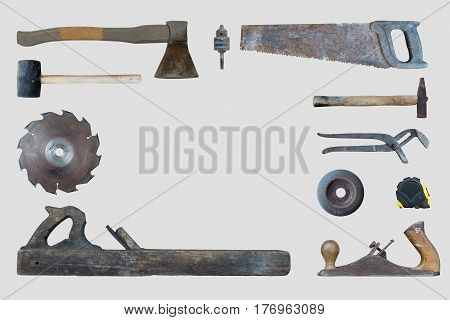Set of old carpenter's shabby scratched instrument on white background. In the center is a place for writing on a white background. View from above. Flat lay.