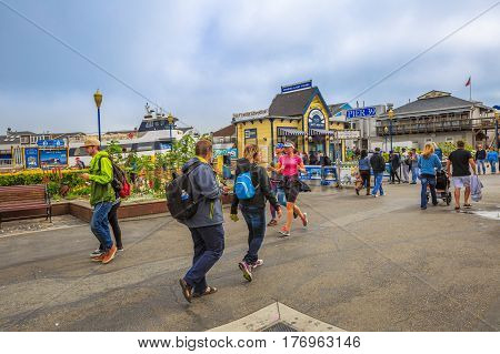 San Francisco, California, United States - August 14, 2016: famous landmark Pier 39 at Fisherman's Wharf. Visitors walk on Pier 39 stores and restaurants in San Francisco. American travel holidays.