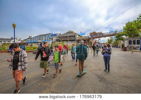 San Francisco, California, United States - August 14, 2016: people and tourists at Fisherman's Wharf district at Pier 39 along the Embarcadero in San Francisco. Leisure, holidays and travel concept.