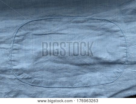 light blue cotton fabric texture with patch useful as a background