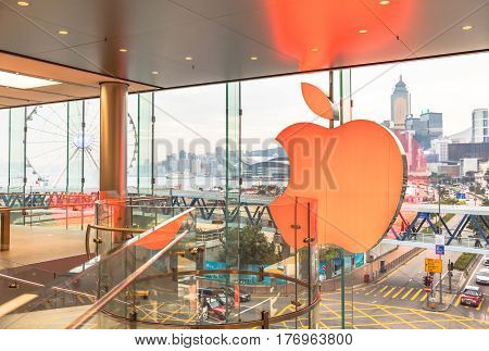 Hong Kong, China - December 4, 2016: second floor Apple store of IFC Mall, Central District skyline with Observation Ferris Wheel outside the crystal window. Modern technological city concept.