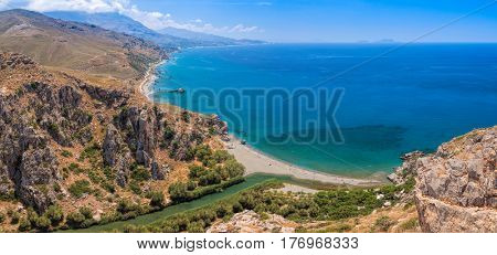 Aerial panoramic view of Preveli palm beach and lagoon near Rethymno in Crete,  Greece, Mediterranean