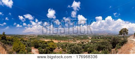 Panoramic view of summer Crete Greek Island with olive tree plantations mountains and Libyan Sea in background