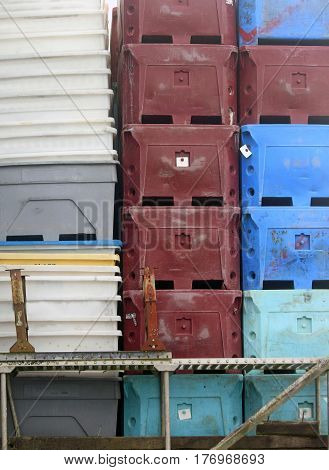 Stacked Fish Packing Crates on a Dock