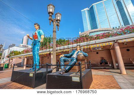 Hong Kong, China - December 5, 2016: Wang Xiao Hu and Hui Lok, statues of famous characters, in Hong Kong Avenue of Comic Stars, Kowloon Park, Tsim Sha Tsui District. Sunny day, blue sky