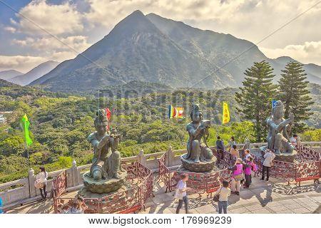Hong Kong, China - December 11, 2016: Bronze statues around Big Buddha, religious icon of Hong Kong. The offering of the six Devas for Tian Tan Buddha on Lantau Island.