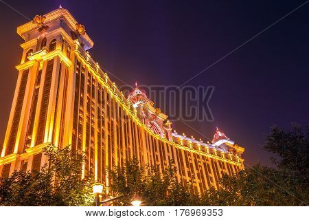 Macau, China - December 8, 2016: perspective view of Galaxy Macau Casino hotel at night, Cotai Strip, the popular street of casinos that annually attracts more than 25 million of people.