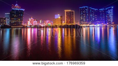 Macau, China - December 9, 2016: Panorama of Macao with Wynn Macau, Casino Lisboa and Grand Lisboa hotel, popular casino from Nam Van Lake, a man-made lake in the southern end of Macau Peninsula.