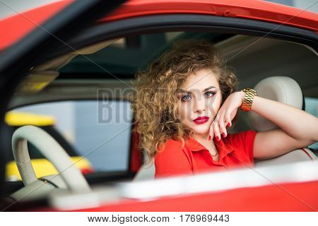 Young Beautiful Woman In Her Car Smiling