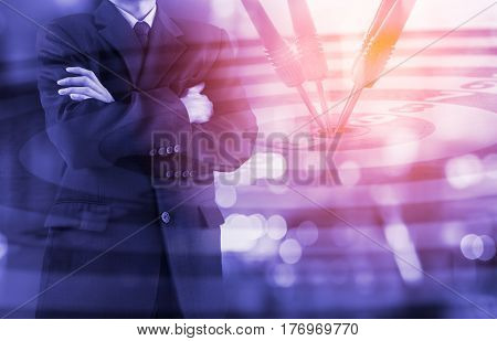 Business Man On Digital Stock Market Financial And Dart Background. Digital Business And Stock Marke