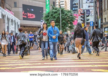 Hong Kong, China - December 6, 2016: asian couple shopping in Times Square, largest shopping mall in Causeway Bay, the luxury shopping district.
