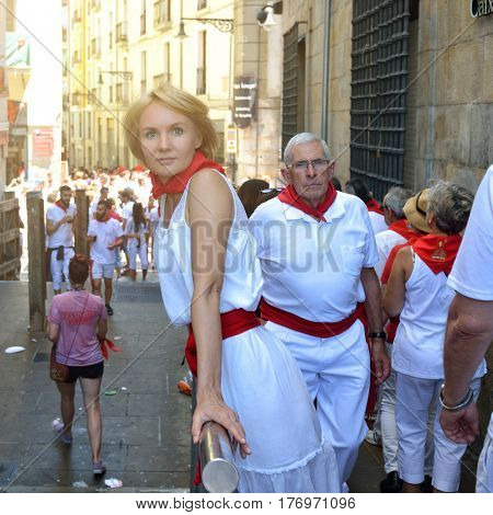 Woman on festival San Fermin, Pamplona, Spain. People celebrate San Fermin festival in traditional white abd red clothing with red necktie, 06 July 2016, Pamplona, Navarra, Spain.