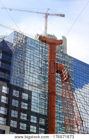 pile construction crane in site around high rise glass building in Jakarta Indonesia photo