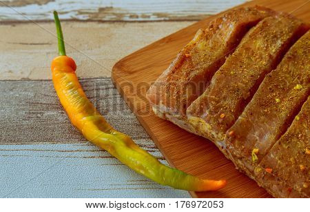 Raw Pork Steak With Branch And Hot Pepper