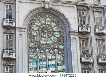 beautiful stained glass window on classical european style building with church facade photo