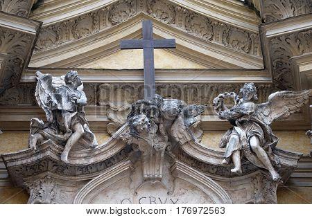 ROME, ITALY - SEPTEMBER 05: Angels and cross, facade of Santa Maria Maddalena Church in Rome, Italy on September 05, 2016.