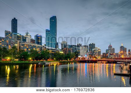 Melbourne Australia - December 27 2016: Melbourne city lights and Yarra river at night viewed from Southbank