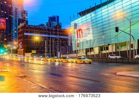 Melbourne Australia - December 27 2016: Melbourne taxi cars in the city queued for passengers pickup near Crowne Plaza hotel at night