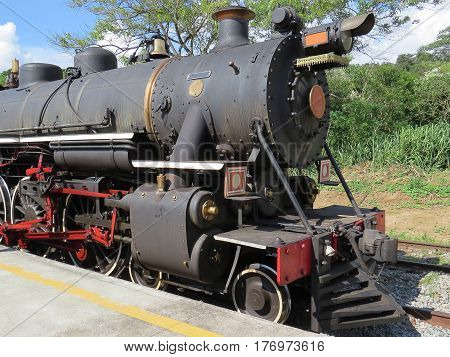 Steam train locomotive, stop at small railroad station, waiting for the next departure, in the countryside, Brazil