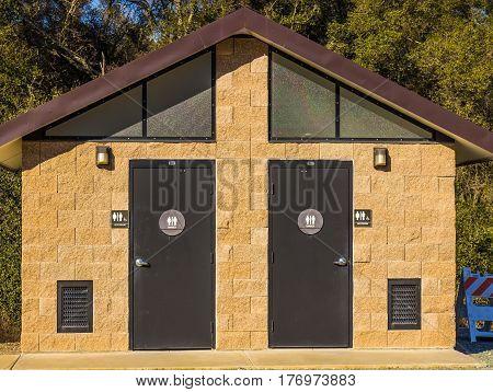 His & Hers Unisex Restroom Building In Park