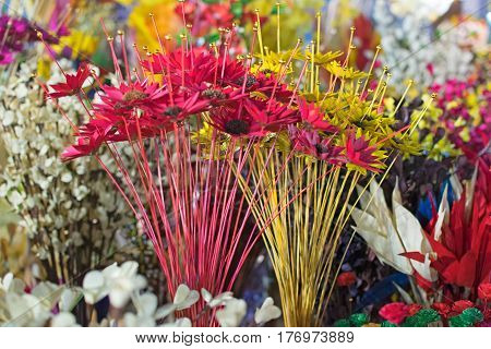 Artificial flowers made out of colored plastics handicrafts on display during the Handicraft Fair in Kolkata earlier Calcutta West Bengal India. It is the biggest handicrafts fair in Asia.