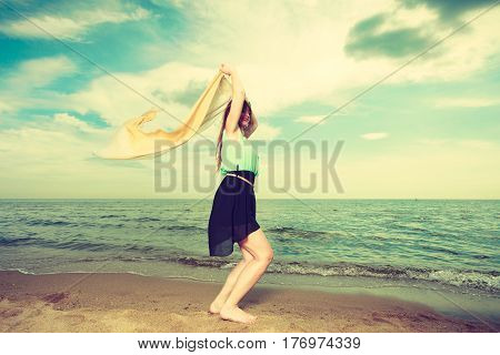 Woman With Shawl Running On Beach