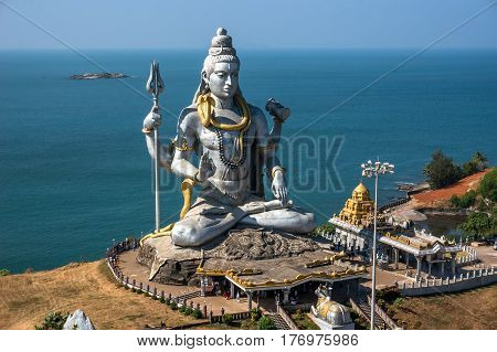 Hindu god statue lord Shiva sculpture sitting in meditation India