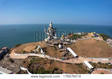 Statue of Lord Shiva was built at Murudeshwar temple on the top of hillock which overlooks the Arabian Sea and it is 37 meters in height. Murudeshwar. Karnataka India