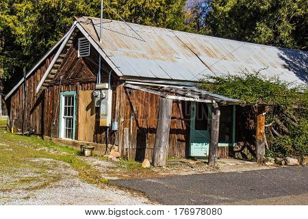Abandoned Rustic Wood Sided Cabin With Roof
