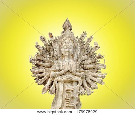 The chinese god, Guan Yin showing 1000 hands on yellow background