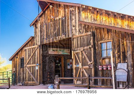 Large Double Door Wooden Barn With Hitching Post Outside