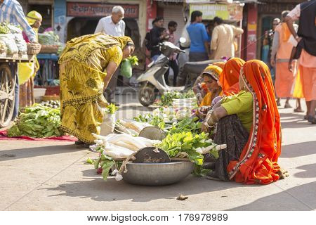 PUSHKAR INDIA-OCT 30 : candid shot of india woman vegetable seller at marketplace in Pushkar on october30 2014 india.
