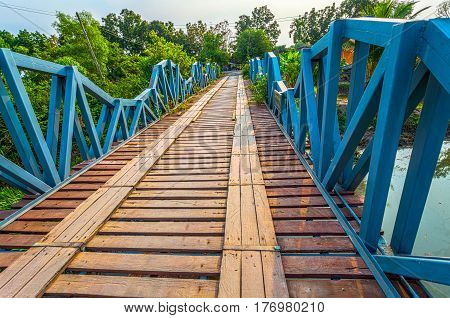 Wooden Bridge Across Canal
