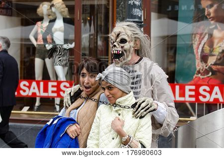 A Man In A Monster Mask Captures Two Tourists Girls On Vienna Street