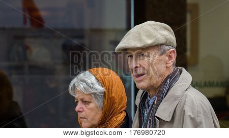 An Elderly Couple Of Tourists At Vienna Streets. Austria