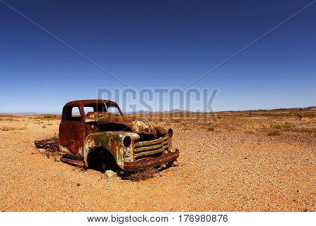 rusted car in the hot African desert
