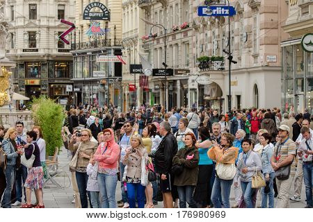Group Of Tourists On The Main Vienna Shopping Street