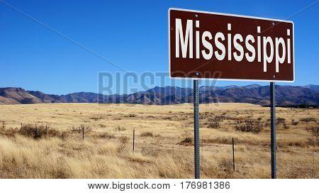 Mississippi road sign with blue sky and wilderness