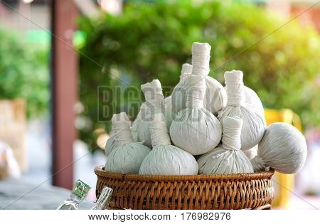 Herbal compress on wood basket in the local market thailand.
