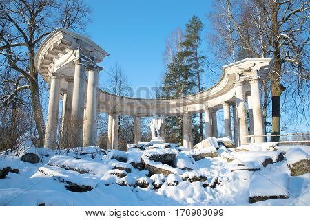 View of the colonnade of Apollo in Pavlovsk palace park on a sunny February day. Saint-Petersburg
