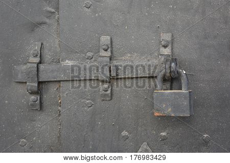 Old metal door padlock with iron forged