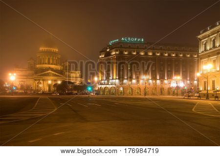ST. PETERSBURG, RUSSIA - MARCH 12, 2017: Foggy March night on the St. Isaac's square. View of St. Isaac's Cathedral and Astoria hotel