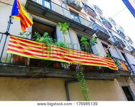 Flag of independence movement of Catalonia, called Estelada, waving in a street of the downtown of Girona, Costa Brava, Catalonia, Spain.
